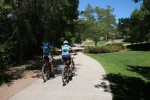 Mountain bikers ride the Animas River Trail behind the Double Tree Hotel.